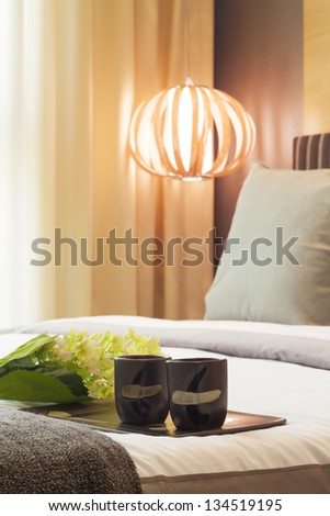 warming bedroom decorated with tea cups. - stock photo
