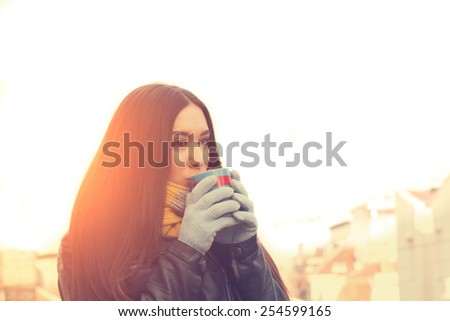 Warming up with some coffee outdoors. - stock photo