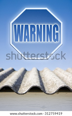 Warning asbestos concept. Warning asbestos on road sign against a blue background - stock photo