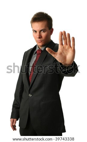 Warning businessmen holding his palm up isolated on white. Face in focus - stock photo