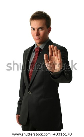 Warning businessmen holding his palm up isolated on white. Palm in focus - stock photo