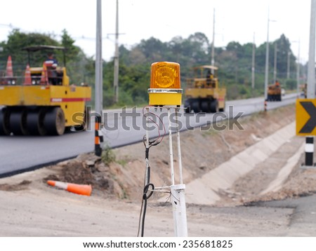 Warning light in construction site - stock photo
