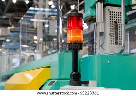 Warning light on a processing machine - stock photo