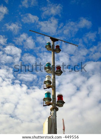 Warning lights at entrance to harbour - stock photo