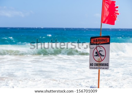 Warning no swimming sign, Sandy beach, Oahu, Hawaii  - stock photo