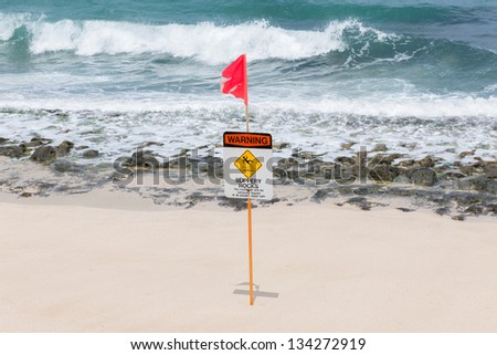 Warning no swimming sign with strong sea wave by the beach background