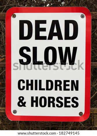 Warning notice - dead slow children and horses - stock photo