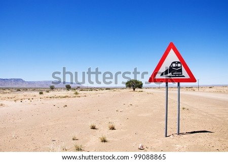 Warning of road sign - train crossing the road, Namibia - stock photo