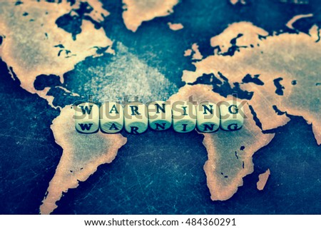 WARNING on grunge world map