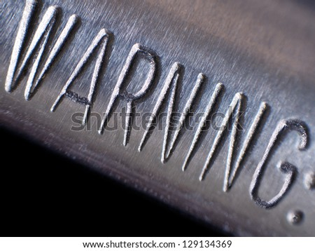 Warning on gun barrel - stock photo