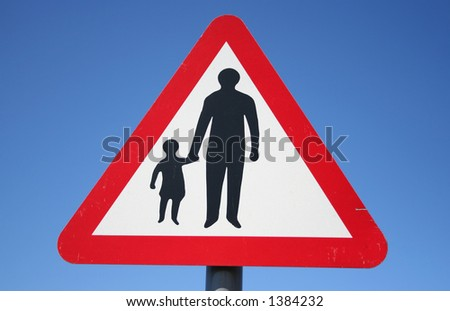 Warning pedestrians on road sign