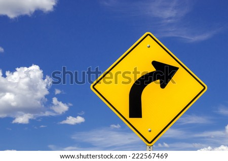 Warning Road Sign Against Dangerous Curve - stock photo