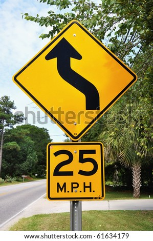 Warning road sign, Curve ahead 25 M.P.H. - stock photo