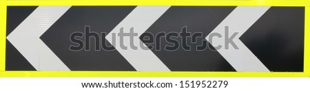 Warning road sign indicating a sharp bend in the road ahead - stock photo
