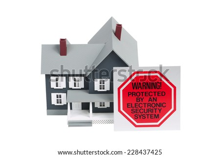 warning sign and house - stock photo