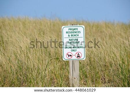 Warning sign at Dunes, Point Betsie, Michigan, USA - stock photo