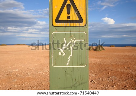 Warning sign at the Elgee cliffs, at the edge of the Nullarbor Plain in South Australia. - stock photo