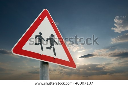 Warning sign, children crossing the road - stock photo