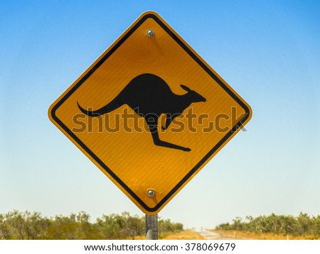 Warning sign for Kangaroo crossing in the Australian outback - stock photo