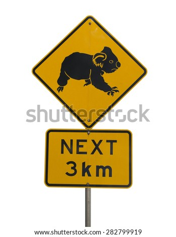 Warning sign for motorists about koala habitat in the next 3 kilometers. Bright yellow diamond shape sign with koala.Isolated image on white background. Location: Queensland, Australia.  - stock photo