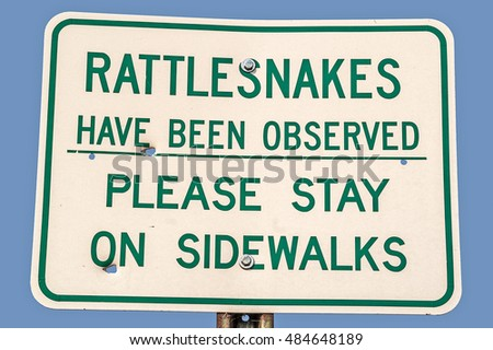 Warning sign for rattlesnakes in the area at a rest stop in Montana