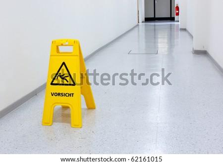 Warning sign for slip hazard - stock photo