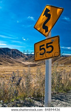 warning sign in New Zealand road. - stock photo