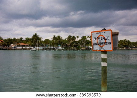 Warning Sign - Manatee Zone - Slow speed, minimum wake - stock photo
