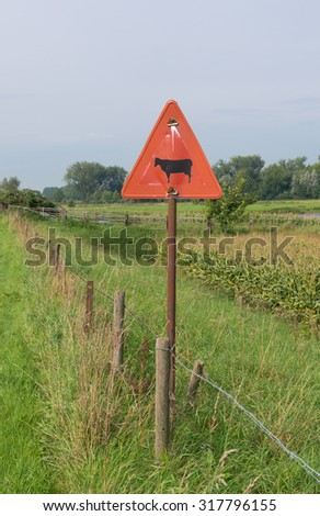 warning sign of cattle crossing a street in the netherlands - stock photo