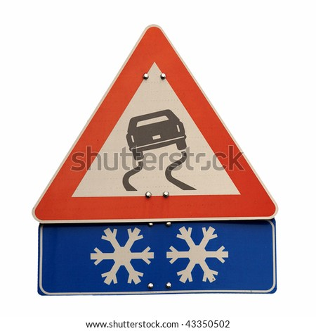 Warning sign of slippery road surface due to snow - stock photo
