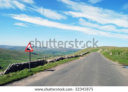 Warning sign on deserted Yorkshire Dales road - stock photo