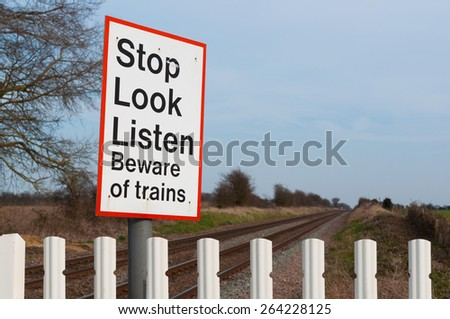 Warning sign on railway level crossing, UK - stock photo