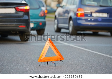warning sign on road after car crash collision accident in city - stock photo