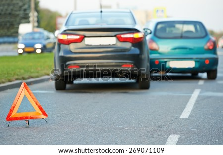warning sign on road behind car crash collision accident in city - stock photo