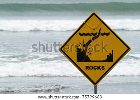 Warning sign on the beach - stock photo