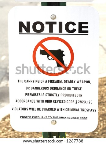Warning sign that guns, firearms, are not allowed. - stock photo