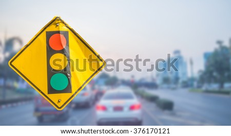 Warning sign : Traffic lights and car at intersection on road background, with  clipping path. - stock photo