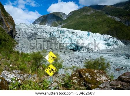 Warning signs at Fox Glacier terminal face - stock photo