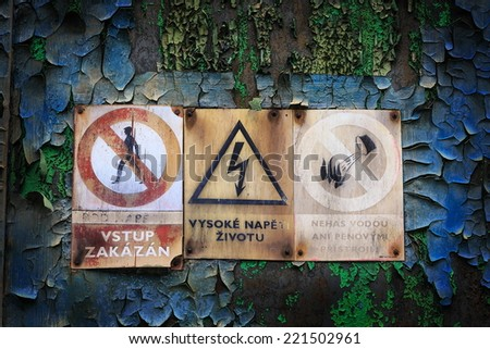 warning signs, entry ban, ban extinguishing water, beware of high voltage - stock photo