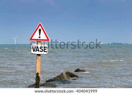 warning signs of flooding mud - stock photo