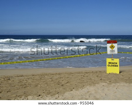 warning signs on the beach: caution and beach closed - stock photo