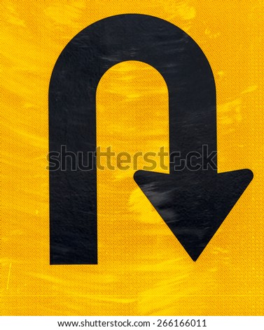 Warning symbol U-Turn ahead on the road - stock photo