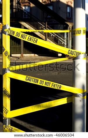 "Warning tape ""Do not enter"" on the street - stock photo"
