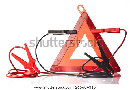 warning triangle and jump start cable - stock photo