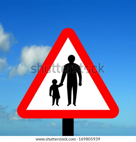 Warning triangle pedestrians in road