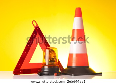 warning triangle, roadside assistance light and traffic cone - stock photo