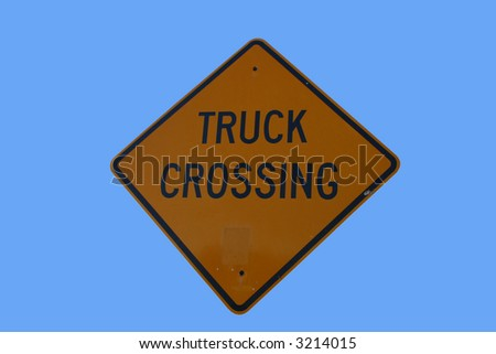 Warning trucks crossing sign isolated on blue - stock photo