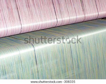 Warp yarns on a loom - stock photo