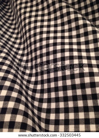 Warped checked fabric, b/w - stock photo