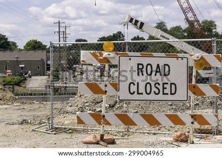 WARRENVILLE, IL, USA - July 22, 2015: Road closure means detours for motorists and pedestrians during a civil engineering project to realign part of a river and replace an old bridge with a new one.